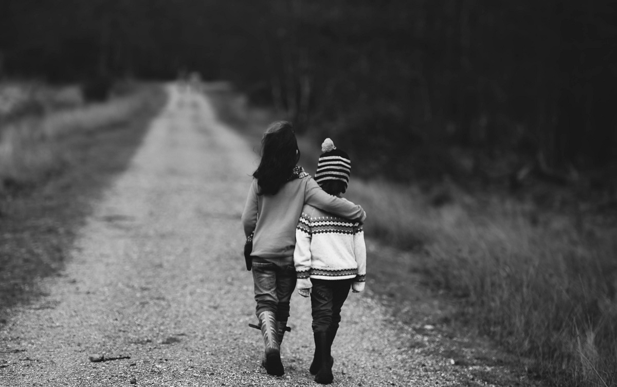 used-boy-girl-bw-walking-embraced-web-1200px