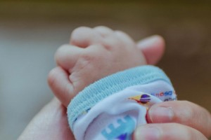 used-tiny-babys-hand-with-mother-website-215x200px